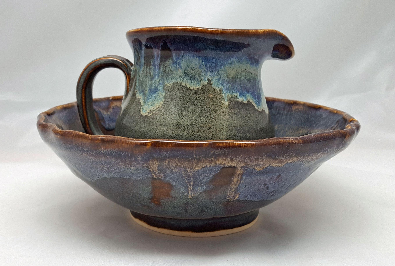Stoneware bowl and pitcher set.