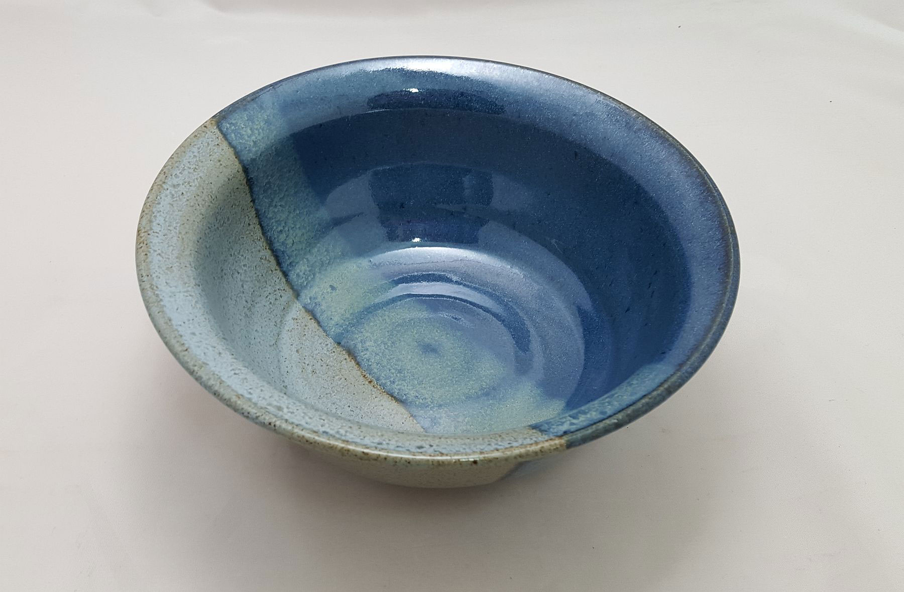 Stoneware bowl in blue duo glaze.